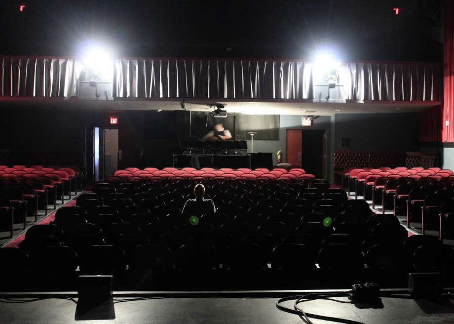 A dedicated projectionist ran the machinery for 40 years at the Brauntex Theatre in New Braunfels. Employees say they think he might be the source of unexpected sounds and lights in the theater. Photo: Picasa / Kathleen Scott/For The Express-News