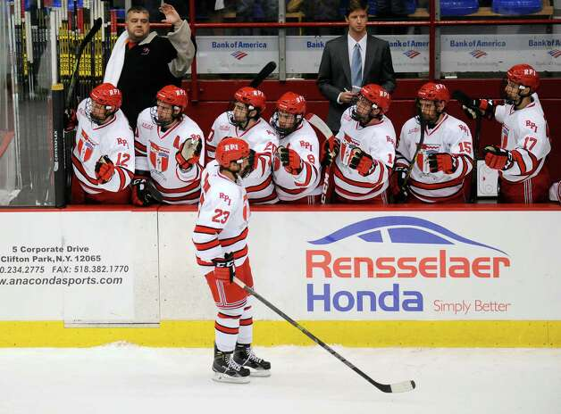 Rensselaer Polytechnic Institute's Lou Nanne (23) celebrates with teammates after scoring his first college goal and the first goal of the season for RPI against Bentley University during the second period of a ECAC college hockey game in Troy N.Y., Friday, Oct. 24, 2014. (Hans Pennink / Special to the Times Union)  ORG XMIT: HP102 Photo: Hans Pennink / Hans Pennink