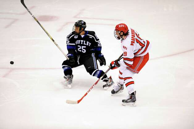 Bentley University's Brett Switzer (25) defends against Rensselaer Polytechnic Institute's (19) Mike Prapavessis's shot during the second period of a ECAC college hockey game in Troy N.Y., Friday, Oct. 24, 2014. (Hans Pennink / Special to the Times Union)  ORG XMIT: HP109 Photo: Hans Pennink / Hans Pennink