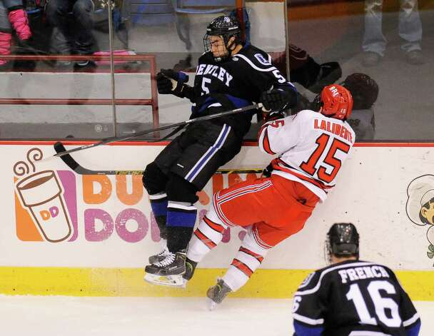 Bentley University's Chris Buchanan (5) and Rensselaer Polytechnic Institute's Jacob Laliberte (15) crash into the boards during the first period of a ECAC college hockey game in Troy N.Y., Friday, Oct. 24, 2014. (Hans Pennink / Special to the Times Union)  ORG XMIT: HP112 Photo: Hans Pennink / Hans Pennink