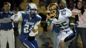Photographs from the Brookfield at Newtown High School boys football game, Friday night, October 24, 2014, in Newtown, Conn.