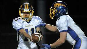 Photographs from the Brookfield at Newtown High School boys football game, Friday night, October 24, 2014, in Newtown, Conn. #11 Brookfield,John Roscigno