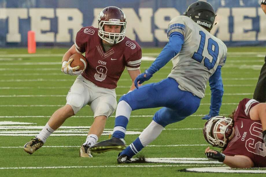 Clear Creek #9 Austin Mathews tries to get past Clear Springs #19 Matthew Testa during the game at Veterans Memorial Stadium 10/23/14 Photo: ÂKim Christensen, Photographer / ©Kim Christensen