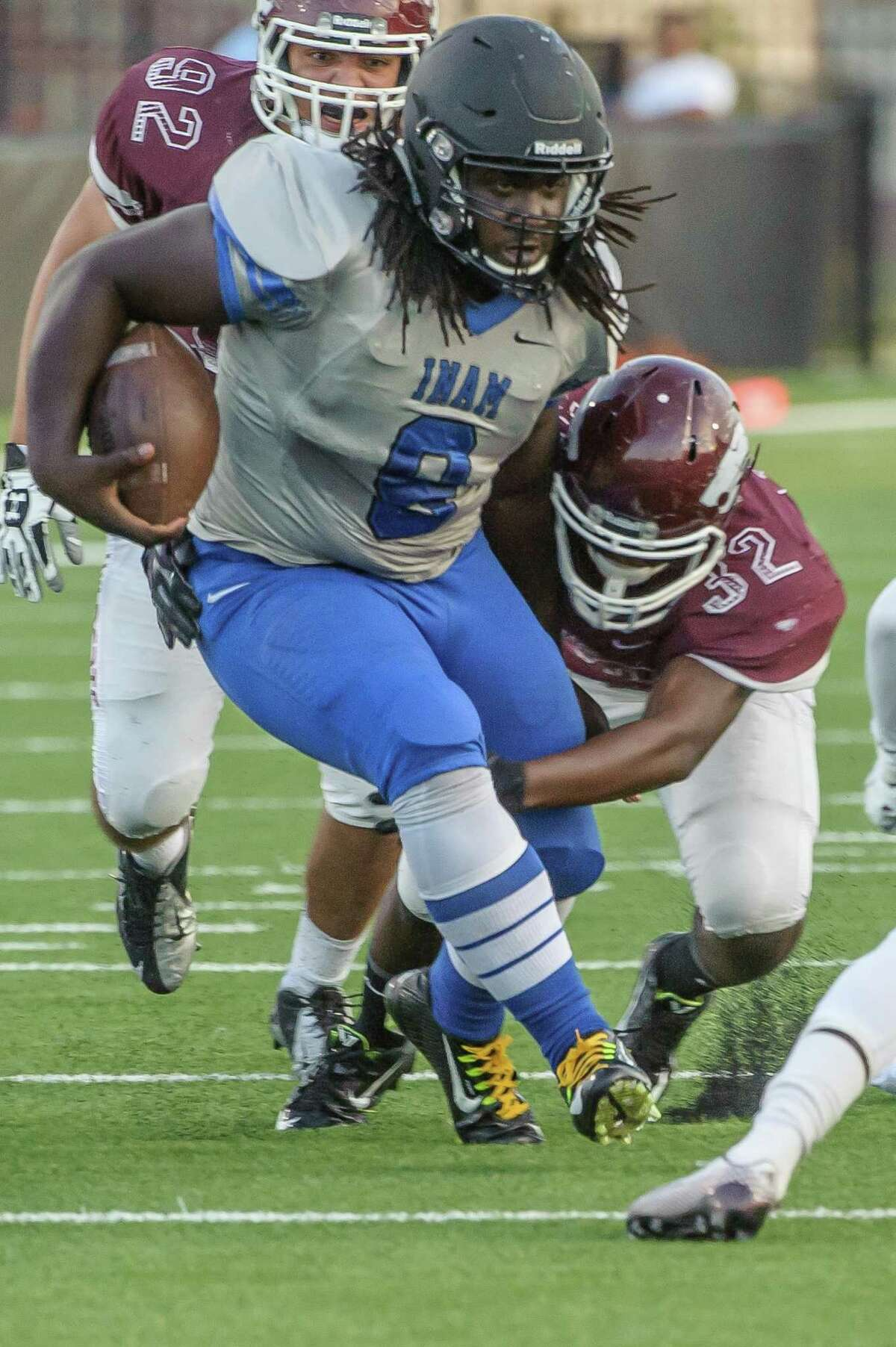 Clear Springs #8 Jared Singleton tries to break away from the Clear Creek's #32 Hisham Walker during the game at Veterans Memorial Stadium 10/23/14during the game at Veterans Memorial Stadium 10/23/14