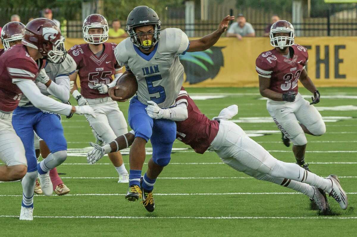 Clear Springs #5 Matthew Guidry tries to break away from the Clear Creek defense during the game at Veterans Memorial Stadium 10/23/14