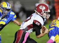 Scotia quarterback Daniel Zeglen runs for a gain during their boy's high school football game against Bishop Maginn on Friday Oct. 24, 2014 in Albany, N.Y.  (Michael P. Farrell/Times Union)