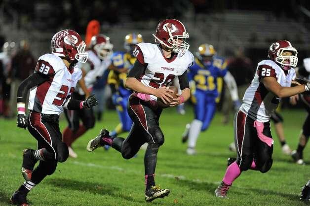 Scotia quarterback Daniel Zeglen runs for a gain during their boy's high school football game against Bishop Maginn on Friday Oct. 24, 2014 in Albany, N.Y.  (Michael P. Farrell/Times Union) Photo: Michael P. Farrell / 00029184A