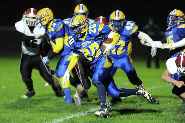 Bishop Maginn's Jaushi'r Weaver break for a gain during their boy's high school football game against Scotia on Friday Oct. 24, 2014 in Albany, N.Y.  (Michael P. Farrell/Times Union) Photo: Michael P. Farrell / 00029184A