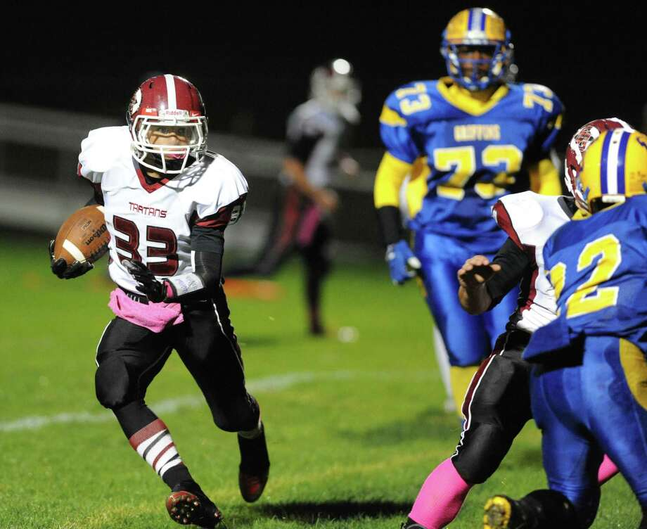 Scotia's Marty McCollum runs for a gain during their boy's high school football game against Bishop Maginn on Friday Oct. 24, 2014 in Albany, N.Y.  (Michael P. Farrell/Times Union) Photo: Michael P. Farrell / 00029184A