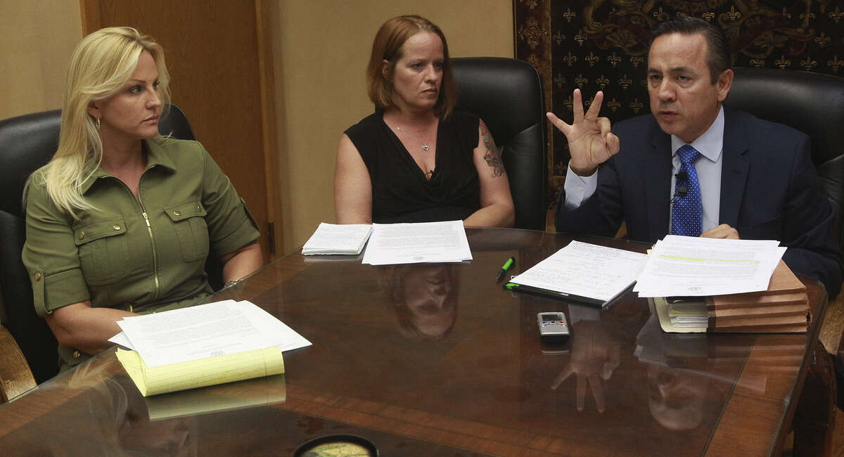 Ex-CPS caseworker Carrie Wilcoxson (from left), Jo-Anne Guerrero and state Sen. Carlos Uresti discuss the report.