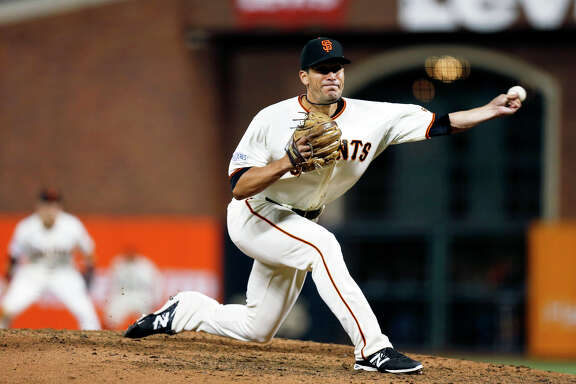 San Francisco Giants pitcher Javier Lopez throws in the sixth inning against the Kansas City Royals in Game 3 of the baseball World Series, Friday, Oct. 24, 2014, in San Francisco. (AP Photo/San Jose Mercury News, Nhat V. Meyer)
