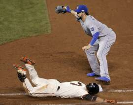 Gregor Blanco dives for a bunt single in the eighth inning, but the ball is already in Eric Hosmer's glove.