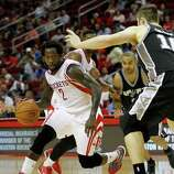Houston Rockets guard Patrick Beverley (2) makes a run to the basket during the first half of an NBA basketball game at the Toyota Center, Friday, Oct. 24, 2014, in Houston.