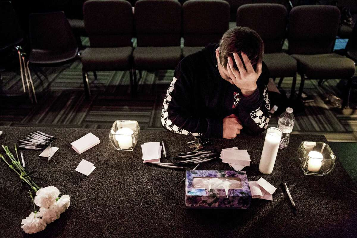 Marysville Pilchuck High School freshman, Cameron Moody, 14, silently prayed amidst candles and Kleenex at a vigil within The Grove Church in mourning of an earlier shooting at his school that left two dead and four wounded Friday, October 24, 2014, in Marysville, Washington. Less than one full quarter into high school, Moody was stunned.