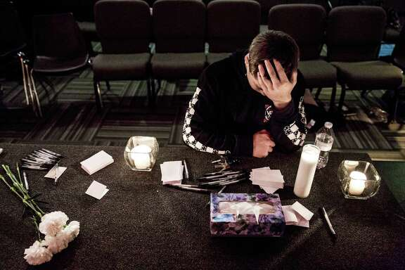 """Marysville Pilchuck High School freshman, Cameron Moody, 14, silently prayed amidst candles and Kleenex at a vigil within The Grove Church in mourning of an earlier shooting at his school that left two dead and four wounded Friday, October 24, 2014, in Marysville, Washington. Less than one full quarter into high school, Moody was stunned. """"I'm not going to be able to walk into the cafeteria the same way,"""" Moody said. """"This is going to change everything for me."""" Several students identified the shooter as Jaylen Fryberg. Providence Regional Medical Center in Everett took in the wounded."""
