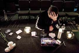 "Marysville Pilchuck High School freshman, Cameron Moody, 14, silently prayed amidst candles and Kleenex at a vigil within The Grove Church in mourning of an earlier shooting at his school that left two dead and four wounded Friday, October 24, 2014, in Marysville, Washington. Less than one full quarter into high school, Moody was stunned. ""I'm not going to be able to walk into the cafeteria the same way,"" Moody said. ""This is going to change everything for me."" Several students identified the shooter as Jaylen Fryberg. Providence Regional Medical Center in Everett took in the wounded."