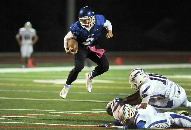 La Salle's Joe Germinerio jumps over Saratoga defenders on his way to a touchdown run during their Class AA quarterfinal high school football game on Friday Oct. 24, 2014 in Watervliet, N.Y.  (Michael P. Farrell/Times Union) Photo: Michael P. Farrell / 00029183A