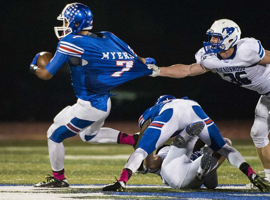 Dickinson wide receiver Jordan Myers (7) is pull down by Friendswood linebacker Casey Thurman (36) during the second half of a high school football game at  Sam Vitanza Stadium, Friday, Oct. 24, 2014, in Dickinson. ( Smiley N. Pool / Houston Chronicle ) Photo: Smiley N. Pool, Houston Chronicle