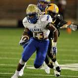 Elkins' Xavier Barnes breaks loose for a big run against Marshall during a high school football game between Elkins and Fort Bend Marshall at Hall Stadium, Friday, Oct. 24, 2014.
