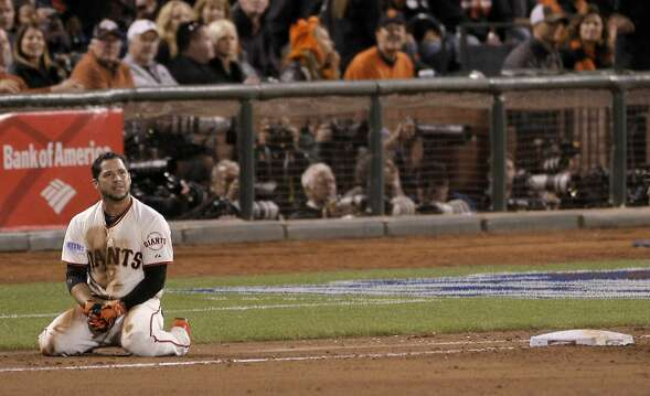 Giants Gregor Blanco sits near first base after being thrown out in the eighth inning during Game 3 of the World Series at AT&T Park on Friday, Oct. 24, 2014 in San Francisco, Calif.