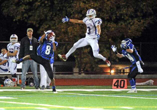 La Salle's Justin Burke intercepts a pass during their Class AA quarterfinal high school football game against Saratoga on Friday Oct. 24, 2014 in Watervliet, N.Y.  (Michael P. Farrell/Times Union) Photo: Michael P. Farrell / 00029183A