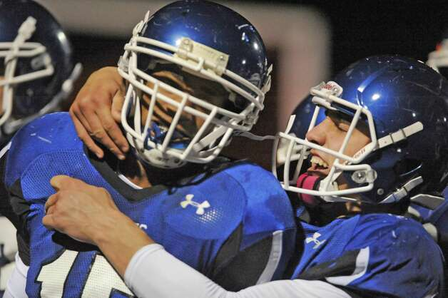 La Salle's Dikemm Edmundson, left, is congratulated quarterback  Joe Germinerio after his touchdown run during their Class AA quarterfinal high school football game against Saratoga on Friday Oct. 24, 2014 in Watervliet, N.Y.  (Michael P. Farrell/Times Union) Photo: Michael P. Farrell / 00029183A
