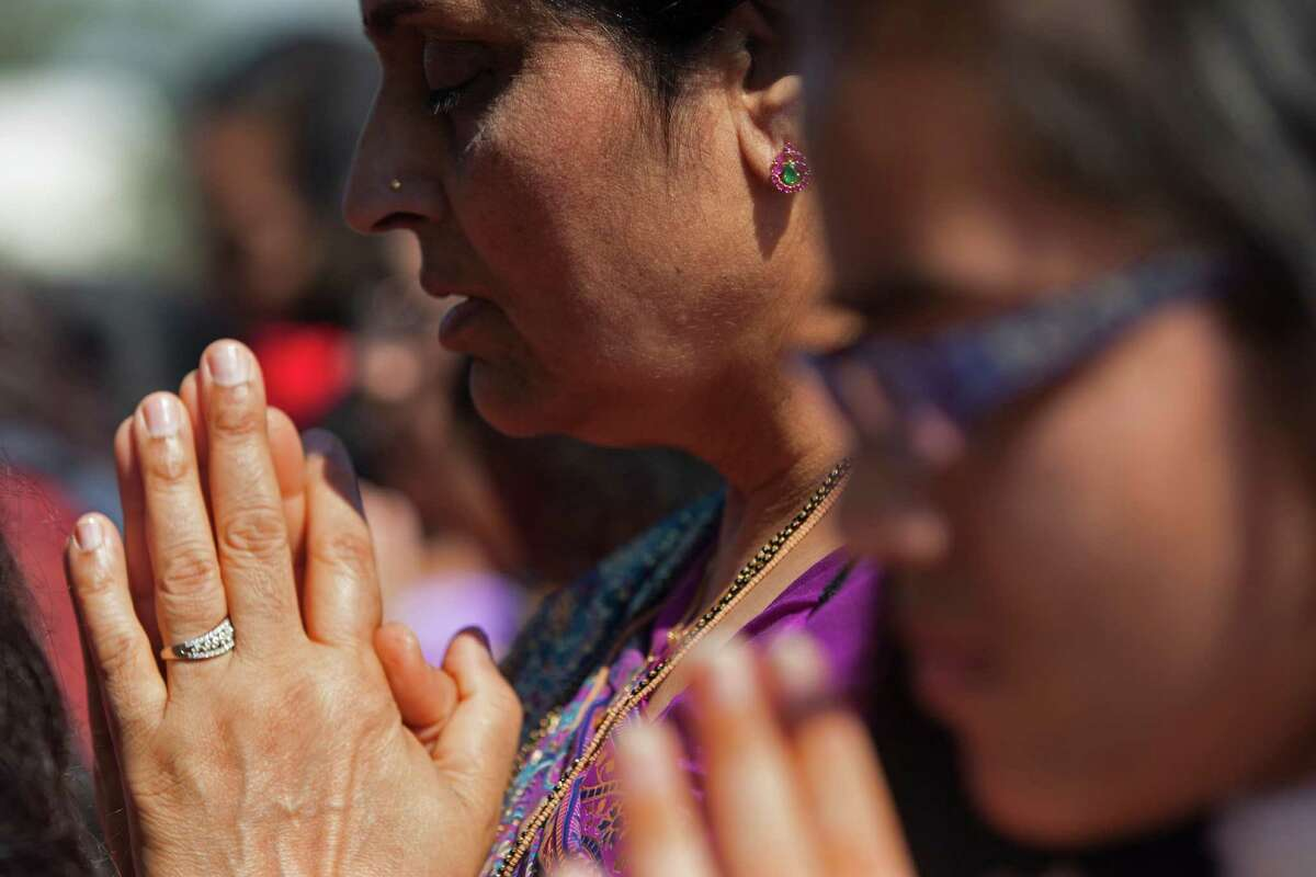 Worshipers offer their prayers, songs and chants to usher in the Hindu New Year during Annakoot celebrations, the day after Diwali at the BAPS Shri Swaminarayan Mandir Friday, Oct. 24, 2014, in Stafford. Hindus offer up vegetarian offerings of food during Annakoot - or mountain of food. Diwali - the festival of lights - was officially yesterday, but the celebration extends over a period of days. It's estimated that more than 100,000 Hindus live in the Houston area.