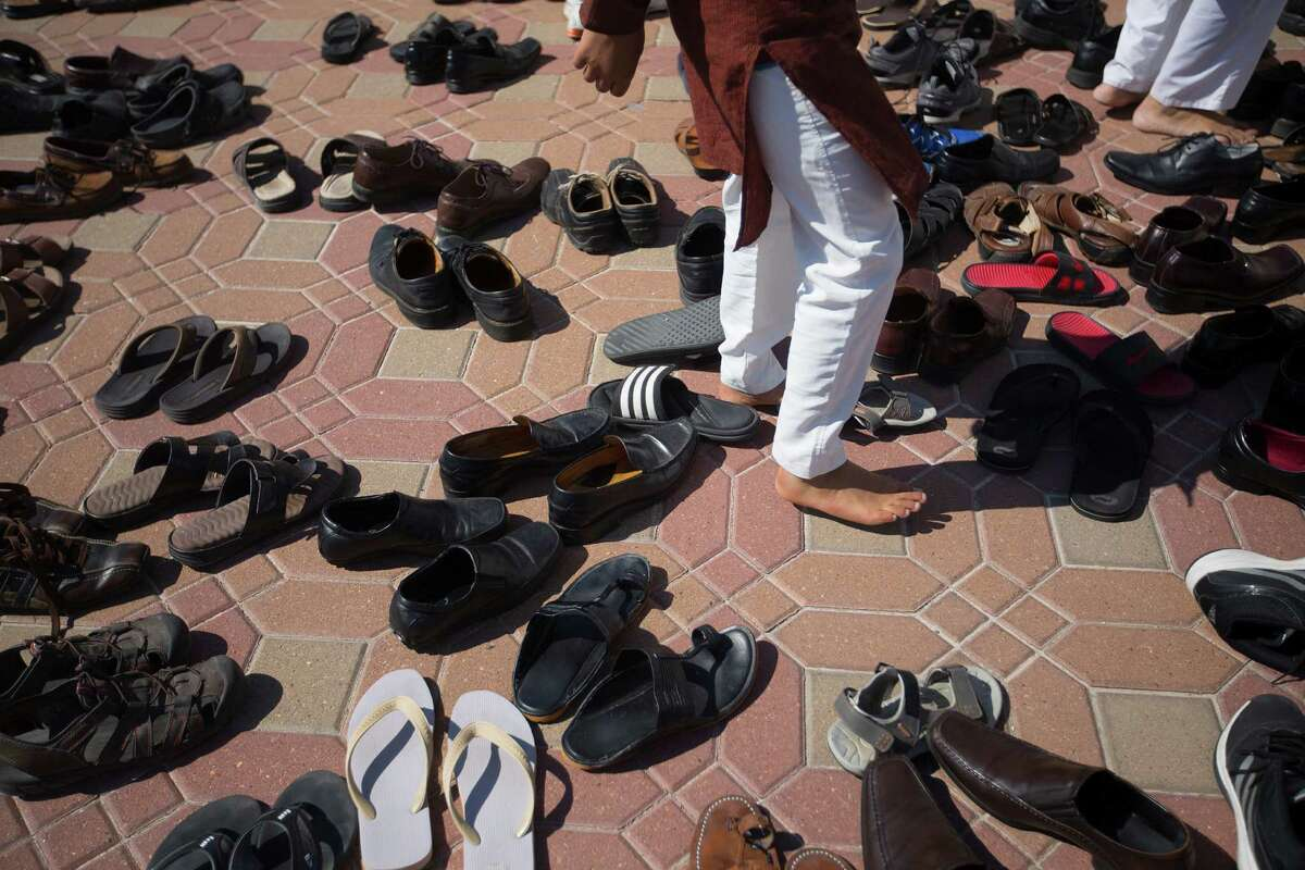 Leaving their footwear behind, worshipers make their way to start the Hindu New Year during Annakoot celebrations, the day after Diwali at the BAPS Shri Swaminarayan Mandir Friday, Oct. 24, 2014, in Stafford.
