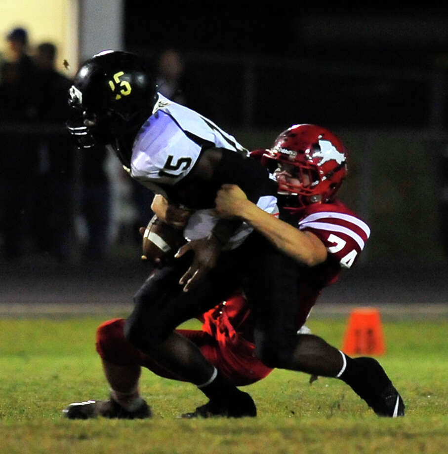 Kountze's Warren Brown takes down a Woodville runner during Friday's home game in Kountze.  Photo taken Friday, October 24, 2014  Kim Brent/@kimbpix Photo: Kim Brent / Beaumont Enterprise