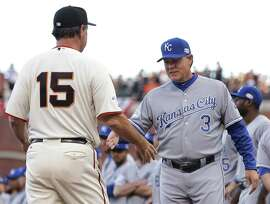 San Francisco Giants manager Bruce Bochy, left, shakes hands with Kansas City Royals manager Ned Yost  before Game 3 of baseball's World Series Friday, Oct. 24, 2014, in San Francisco. (AP Photo/Matt Slocum)