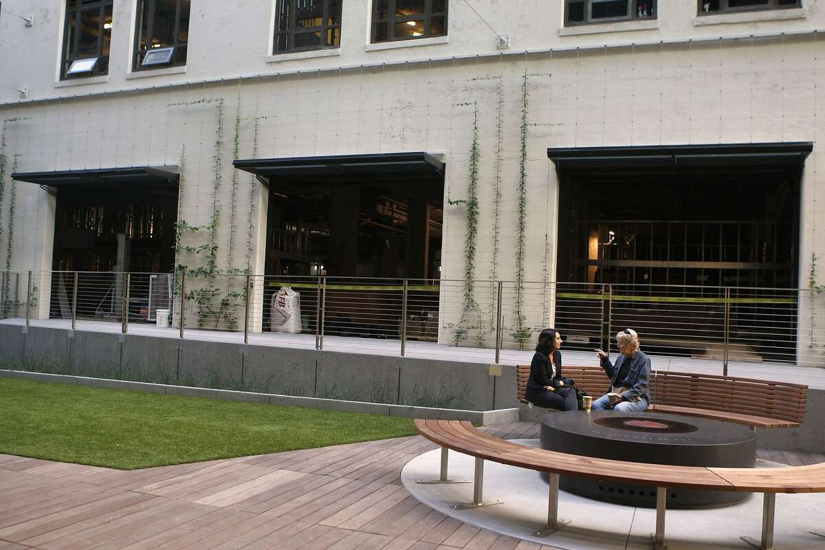 Windows seen open on the bottom level of the Twitter building where construction takes place at a new locally owned grocery store named Market on Market in San Francisco, Calif., on Friday, October 24, 2014. The open windows are entrances to the wine bar and deli of Market on Market.