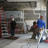 Construction takes place in the meat section and taco bar of the new locally owned grocery store named Market on Market on the first floor of the Twitter building  in San Francisco, Calif., on Thursday, October 23, 2014.