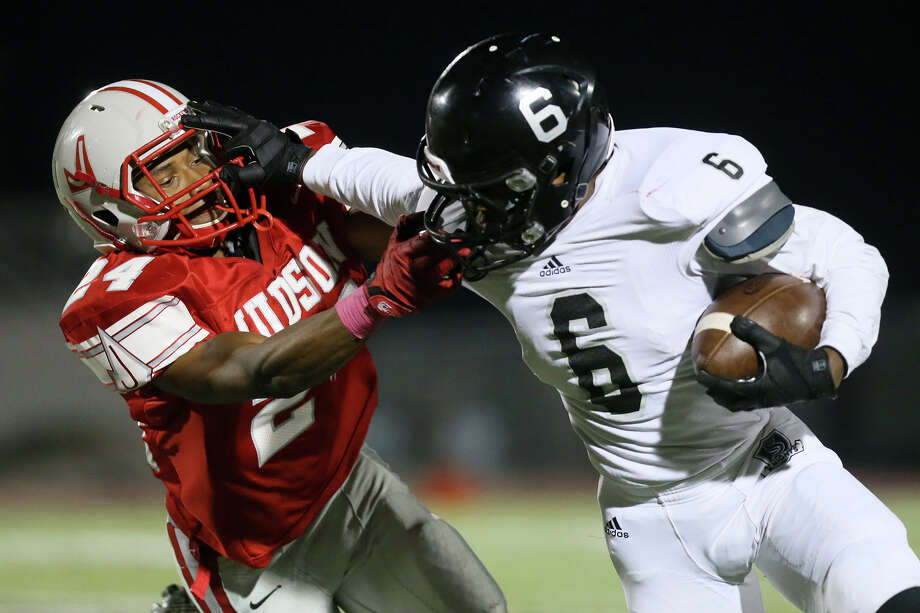 Judson's james Tonsall (left) tries to bring down Steele's C.J. Williams during the first half of their game at Rutledge Stadium on Friday, Oct. 24, 2014.  MARVIN PFEIFFER/ mpfeiffer@express-news.net Photo: MARVIN PFEIFFER,  MARVIN PFEIFFER/ Mpfeiffer@express-news.net / Express-News 2014