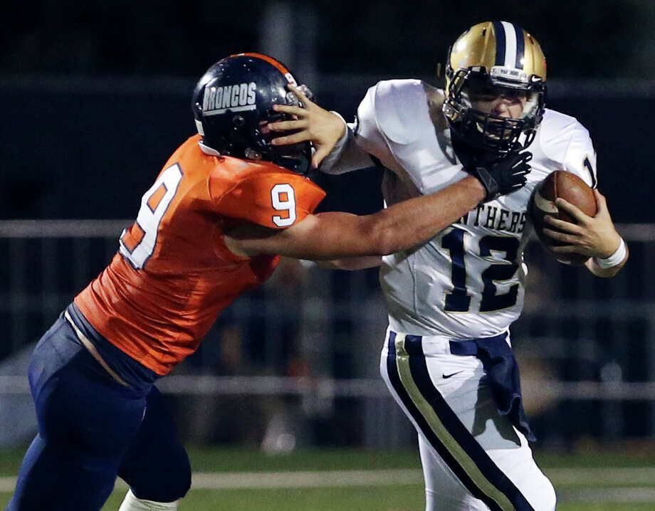 O'Connor's Jonathan McEntire tries to shake the tackle of Brandeis' Brandon Smyth during first half action Friday Oct. 24, 2014 at Farris Stadium. Photo: Edward A. Ornelas, By Edward A. Ornelas, Express-News / © 2014 San Antonio Express-News