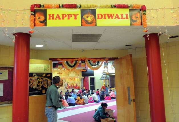 The local Hindu community celebrates Diwali at the Albany Hindu Temple on Saturday Oct. 25, 2014 in Loudonville, N.Y. (Michael P. Farrell/Times Union) Photo: Michael P. Farrell / 00029185A