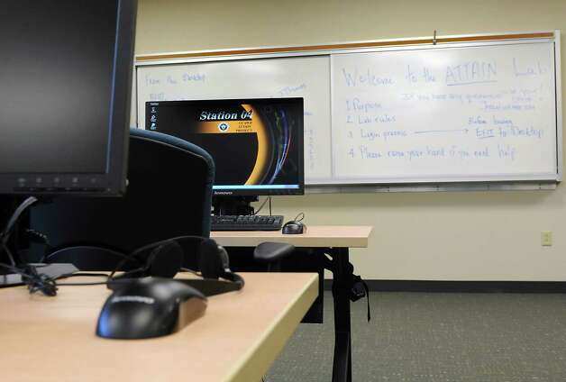 New computers are set up in the ATTAIN Lab that will help area residents prepare for technology careers at Capital South Campus Center -Trinity Alliance on Thursday, Oct. 23, 2014 in Albany, N.Y.  (Lori Van Buren / Times Union) Photo: Lori Van Buren / 00029181A