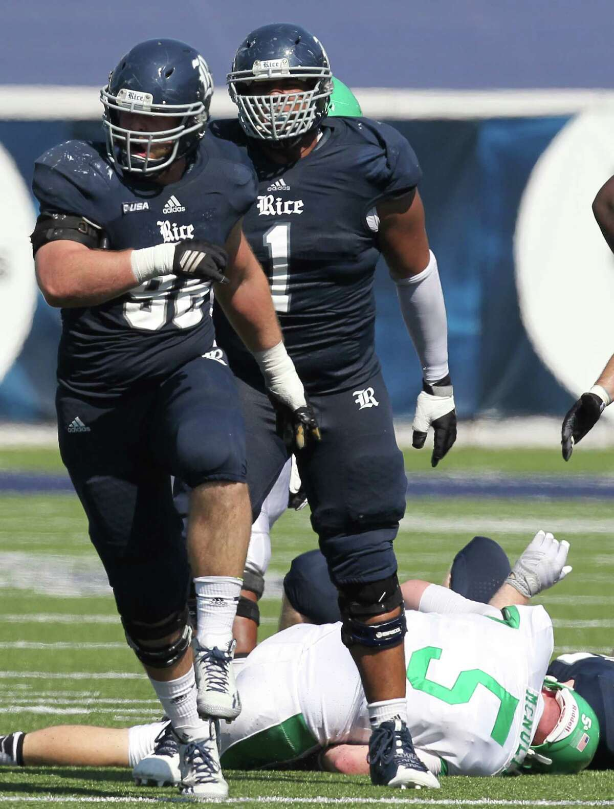 Rice Owls defensive end Dylan Klare (96) celebrates after sacking North Texas Mean Green offensive lineman Kaydon Kirby (50) for a loss in a Conference USA football game in the first half on Saturday, October 25, 2014 at Rice Stadium in Houston, TX.