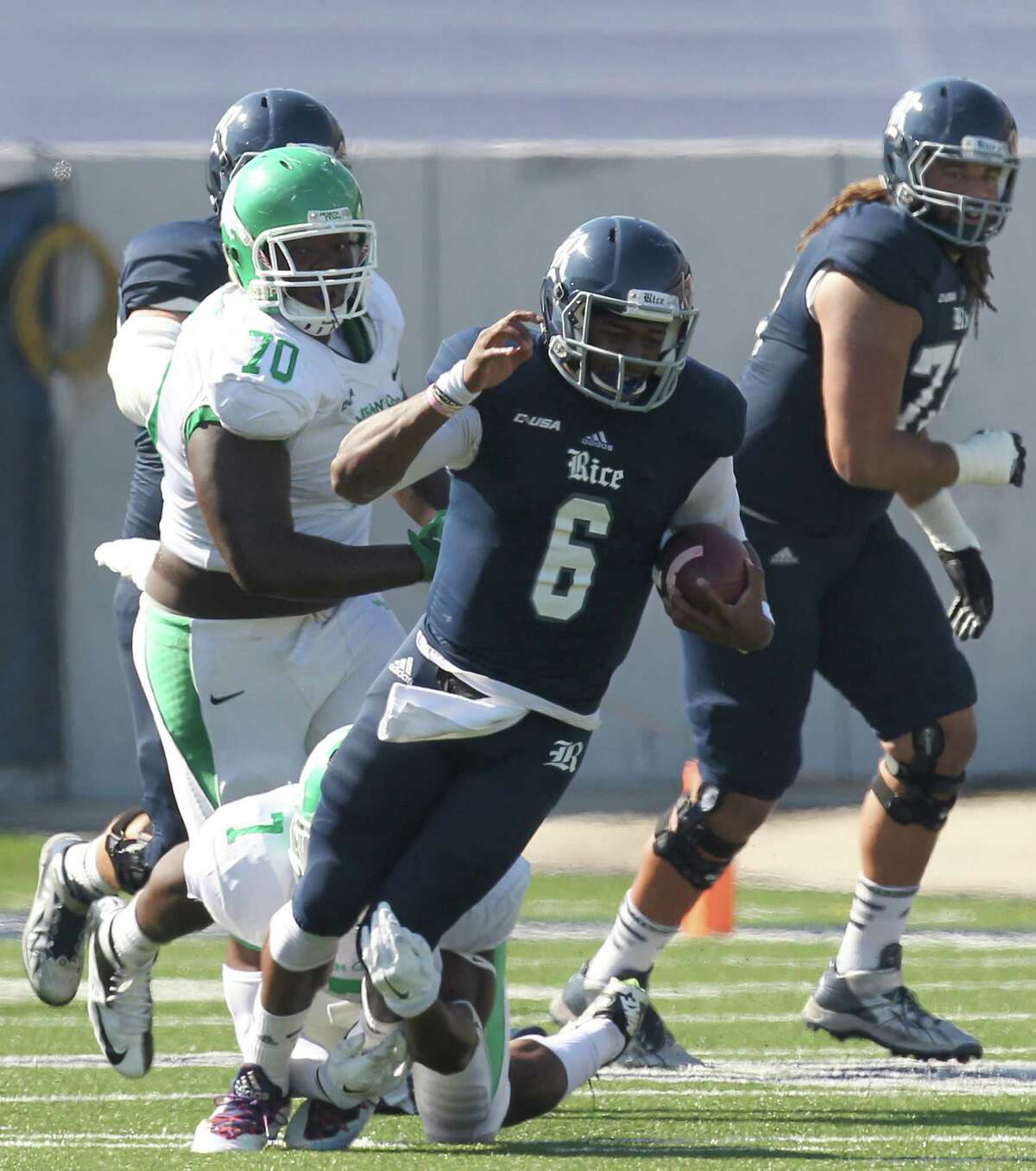 Rice Owls quarterback Driphus Jackson (6) is sacked by North Texas Mean Green linebacker Derek Akunne (7) in a Conference USA football game in the first half on Saturday, October 25, 2014 at Rice Stadium in Houston, TX.
