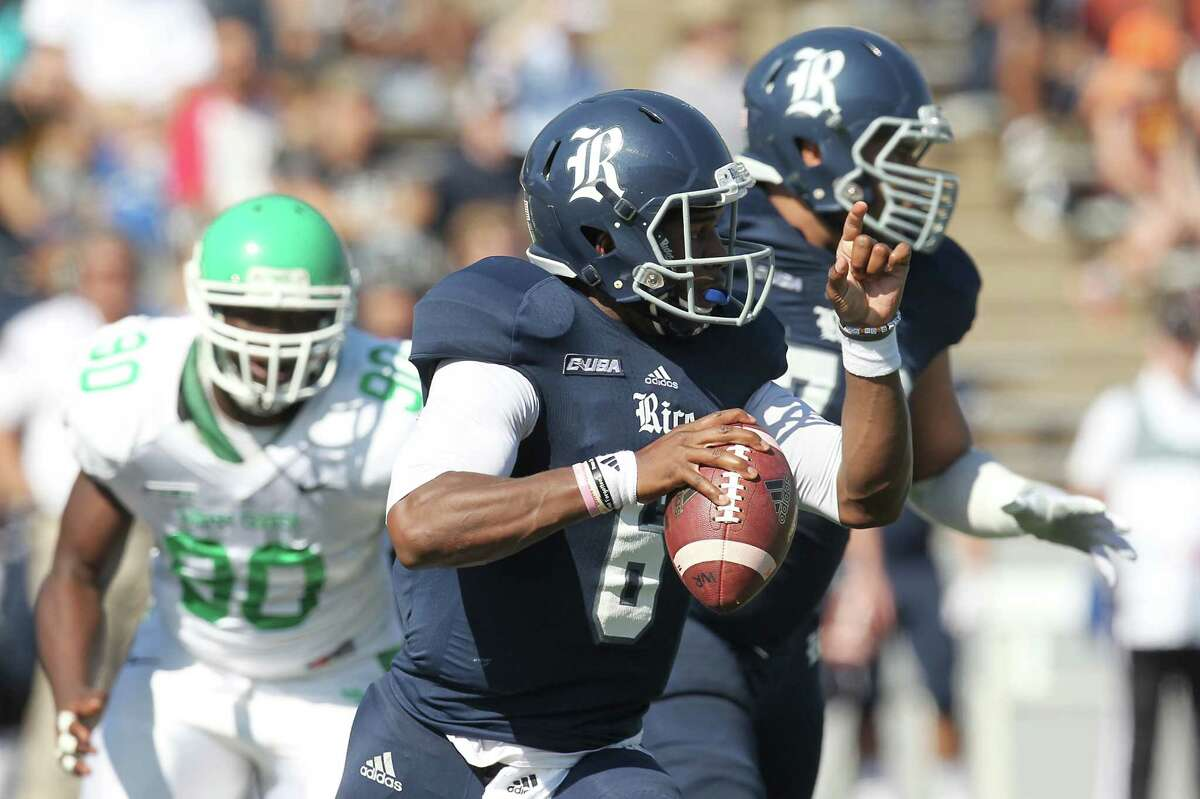 Rice Owls quarterback Driphus Jackson (6) scrambles agains the North Texas Mean Green defense in a Conference USA football game in the first half on Saturday, October 25, 2014 at Rice Stadium in Houston, TX.