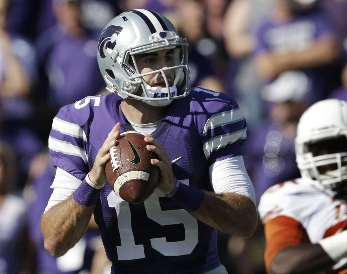 8. NFL arm? Kansas State quarterback Jake Waters makes the Wildcat offense tick and finished second in passing efficiency rating in the Big-12 this year. UCLA's defense singled out Waters as the player to stop in the Jan. 2 matchup, citing his ability to extend plays. Waters isn't high on the NFL prospect list but CBS Sports has Waters as a potential seventh-round pick. Photo: Kansas State quarterback Jake Waters looks for a receiver during the first half of an NCAA college football game against Texas in Manhattan, Kan., Saturday, Oct. 25, 2014. (AP Photo/Orlin Wagner)