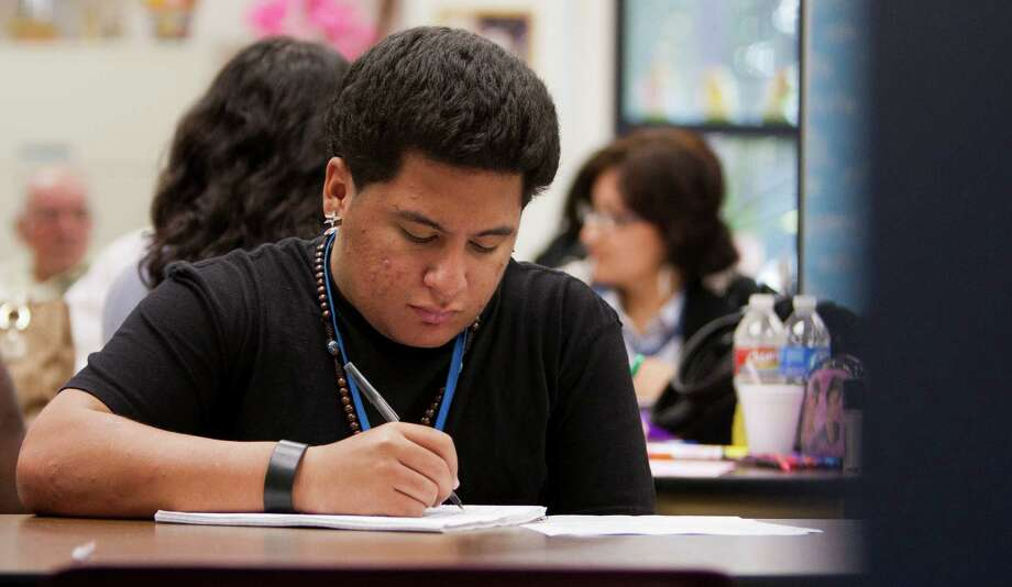 Kendrick Zapata, 17, works on an assignment in his GED class at the Harris County Department of Education Adult Learning Center in 2011.  Photo: Andrew Richardson, Staff / © 2011 Houston Chronicle