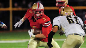 Stratford's Sam Breiner carries the ball, during football action against Notre Dame of Fairfield in Stratford, Conn. on Friday October 24, 2014.