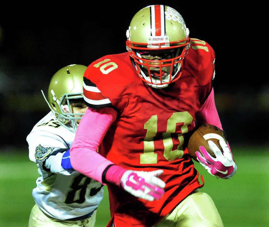 Stratford's Marquess Daniels carries the ball, during football action against Notre Dame of Fairfield in Stratford, Conn. on Friday October 24, 2014. Photo: Christian Abraham / Connecticut Post