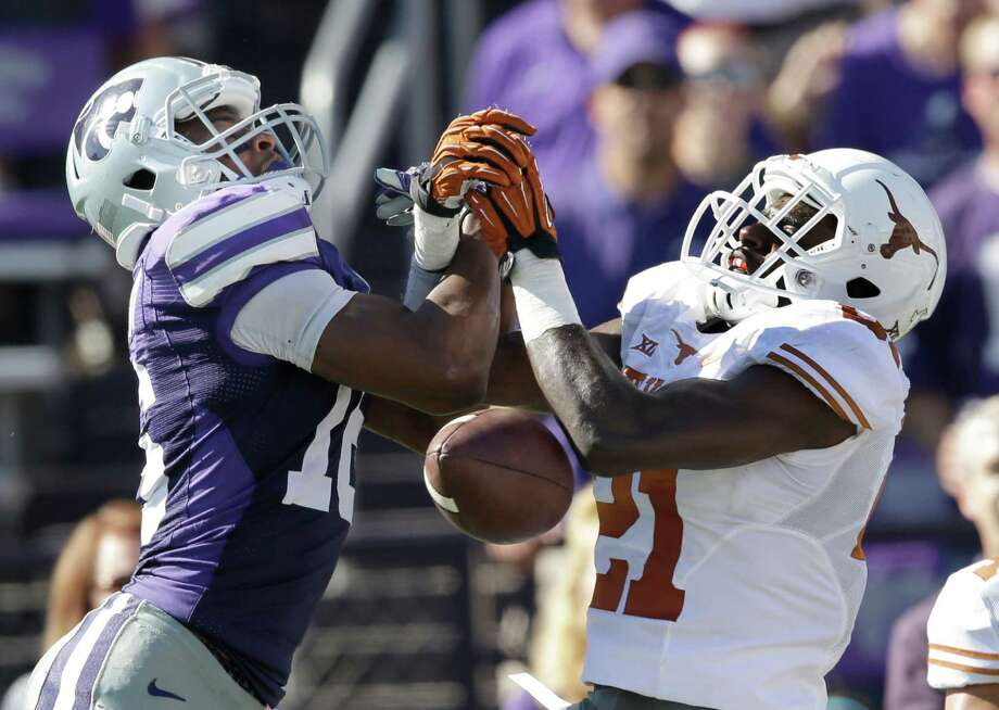 Texas cornerback Duke Thomas (21) knocks a pass away from Kansas State wide receiver Tyler Lockett (16) during the second half of an NCAA college football game in Manhattan, Kan., Saturday, Oct. 25, 2014. Kansas State defeated Texas 23-0. (AP Photo/Orlin Wagner) Photo: Orlin Wagner, Associated Press / AP