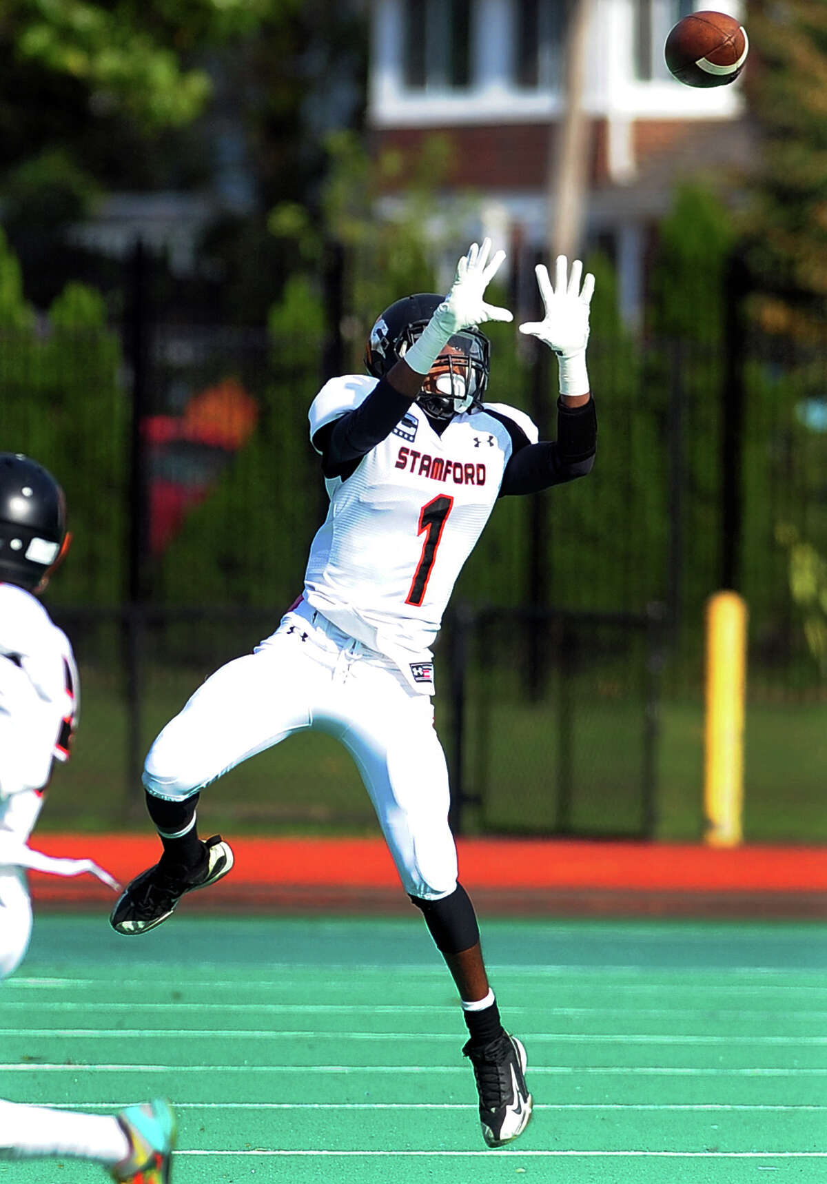Stamford's Ziaire Mabry leaps to grab a pass, during football action against Bassick in Bridgeport, Conn. on Saturday October 25, 2014.