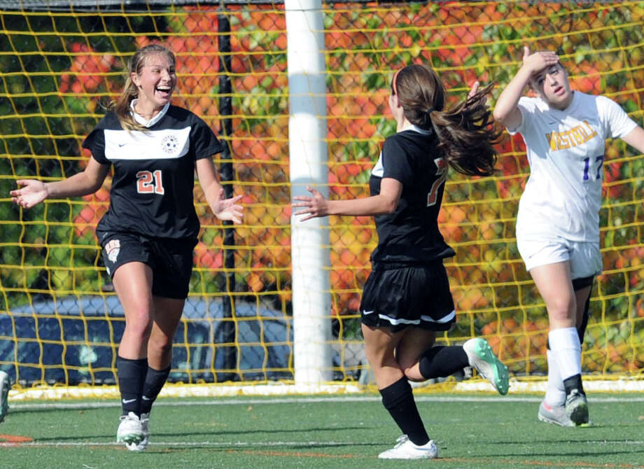 Katherine Jasminski (#21), left, of Ridgefield, reacts after scoring the second goal of the match for her team as her teammate, Sarah Battipaglia, center, comes in to congratulate her during the girls FCIAC quarterfinal soccer match between Westhill High School and Ridgefield High School at Westhill, Stamford, Conn., Saturday afternoon, Oct. 25, 2014. At right is Westhill's Claire Mioline (#17). Ridgefield advanced to the semifinal round with a 2-0 victory over Westhill. Photo: Bob Luckey / Greenwich Time