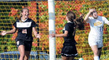 Katherine Jasminski (#21), left, of Ridgefield, reacts after scoring the second goal of the match for her team as her teammate, Sarah Battipaglia, center, comes in to congratulate her during the girls FCIAC quarterfinal soccer match between Westhill High School and Ridgefield High School at Westhill, Stamford, Conn., Saturday afternoon, Oct. 25, 2014. At right is Westhill's Claire Mioline (#17). Ridgefield advanced to the semifinal round with a 2-0 victory over Westhill.