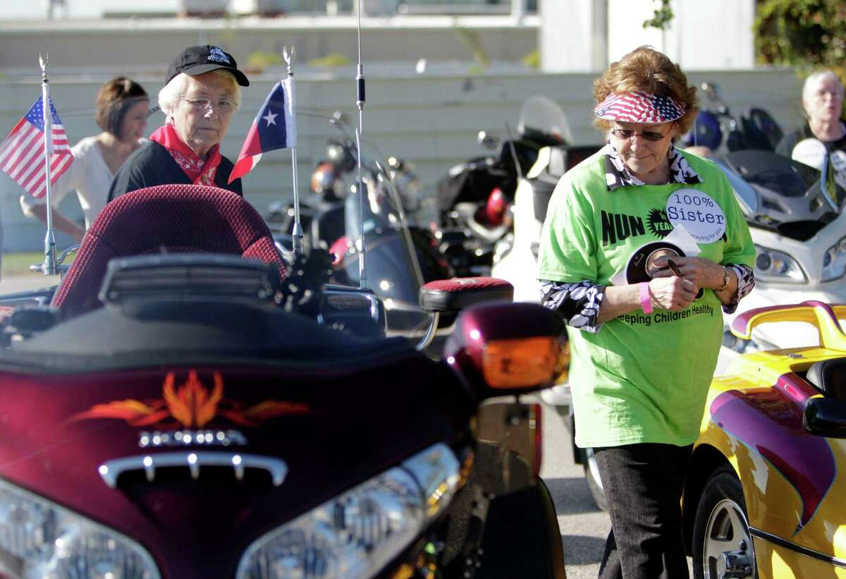Sister Rachel Okeeffe, CCVI, and Sister Rosalie Karstendt, CDP, judge motorcycles during the 10th Annual Nun Run that benefits the Christus Foundation on Saturday, Oct. 25, 2014, in Houston. The Ride is from the East End to Galveston.