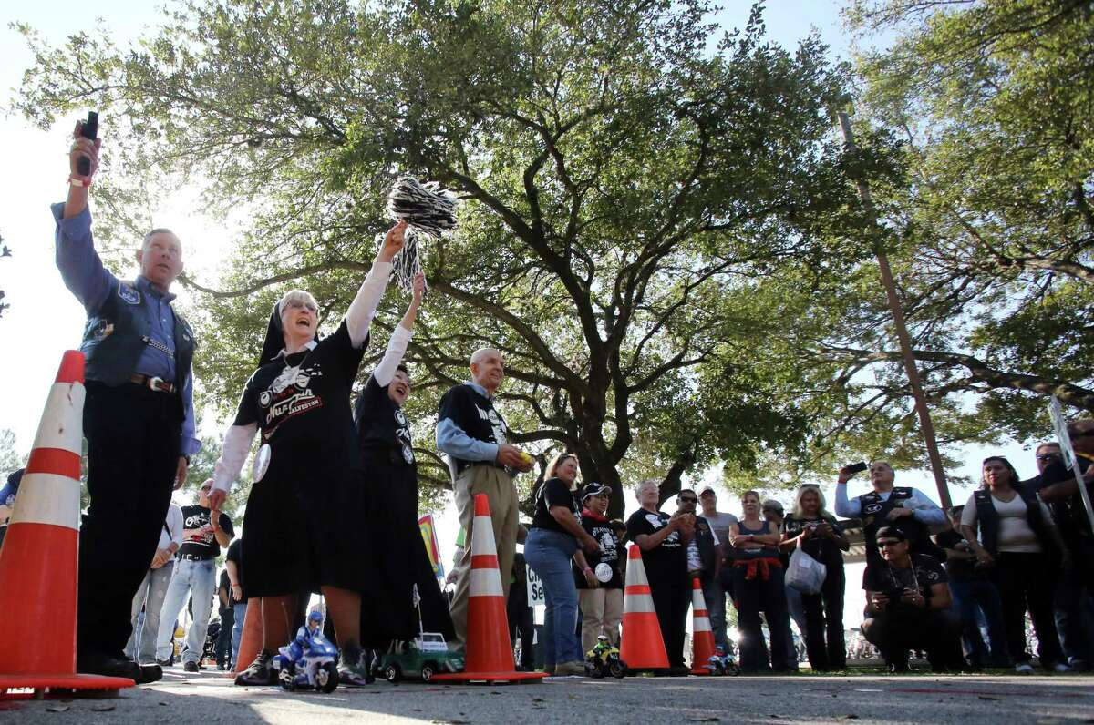 Participates get ready to start a remote control race before rolling out for the 10th Annual Nun Run that benefits the Christus Foundation on Saturday, Oct. 25, 2014, in Houston. The Ride is from the East End to Galveston.