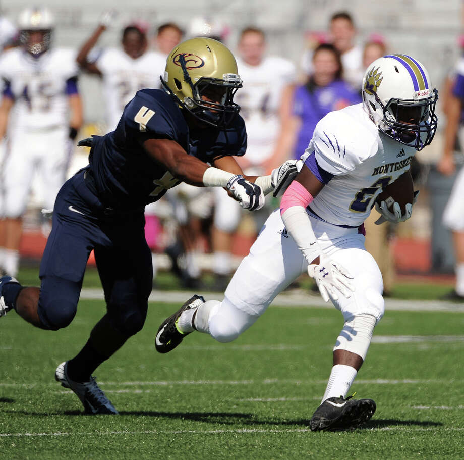 Montgomery wide receiver Anthony Thomas, right, escapes the tackle of Klein Collins defensive back Joseph Graves en route to a 63-yard touchdown during the first half of a high school football game, Saturday, October 25, 2014, at Klein Memorial Stadium in Houston. Photo: Eric Christian Smith, For The Chronicle / 2014 Eric Christian Smith